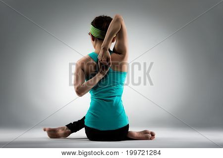 Back View Photo Of Fitness Woman Doing Yoga Posing