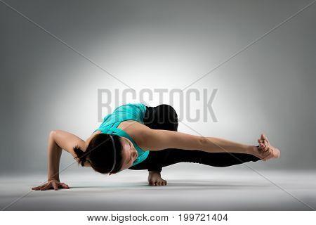 Professional Fitness Coach Woman Doing Yoga Posing