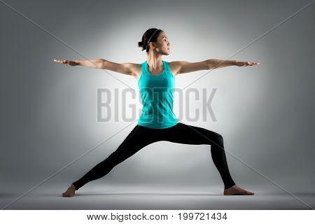 Fitness Teacher Doing Yoga In Grey Background