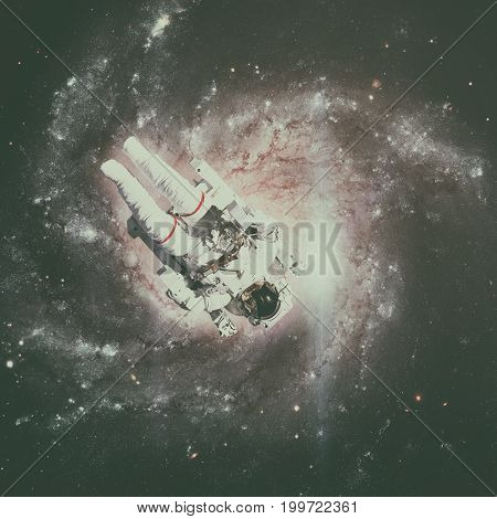Astronaut In Outer Space. Spiral Galaxy On The Background.
