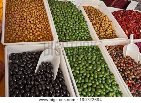 assortment of olives salted preserved in brine or pickle in italian market