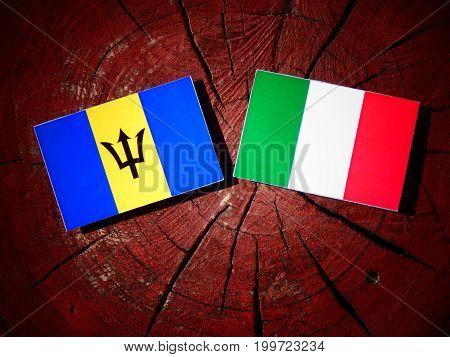 Barbados Flag With Italian Flag On A Tree Stump Isolated