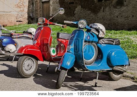 IMOLA (BO) ITALY - APRIL 14: italian scooters Vespa, in the foreground the model 90 Super Sprint with petrol tank in classic scooter rally