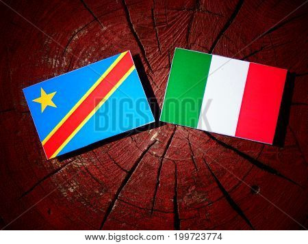 Democratic Republic Of The Congo Flag With Italian Flag On A Tree Stump Isolated
