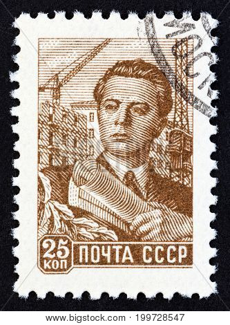 USSR - CIRCA 1959: A stamp printed in USSR shows architect, circa 1959.