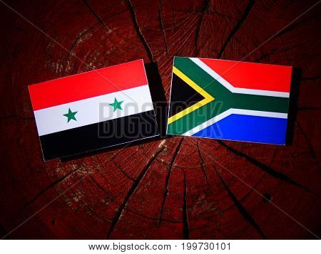 Syrian Flag With South African Flag On A Tree Stump Isolated