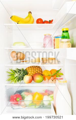 fridge filled with mostly vegetables and fruit, some soy and dairy products too.
