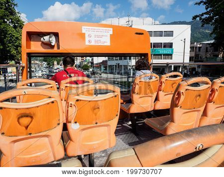 Penang Malaysia - April 24 2017: The double decker hop-on hop-off bus of Penang for city tour of George town and sightseeing around the island with two unidentified passengers.