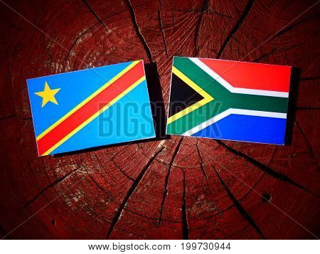 Democratic Republic Of The Congo Flag With South African Flag On A Tree Stump Isolated