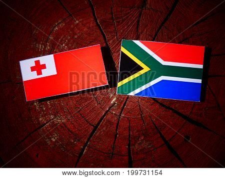 Tonga Flag With South African Flag On A Tree Stump Isolated