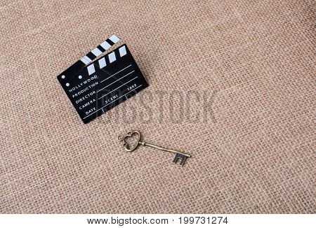 Movie Clapper And Retro Key On Canvas