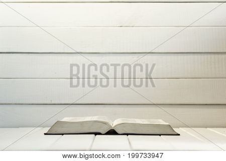 Bible on a white wooden table. Beautiful white wooden background.Religion concept