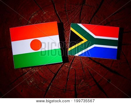 Niger Flag With South African Flag On A Tree Stump Isolated