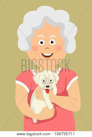 Cute elderly senior woman holding a labrador puppy