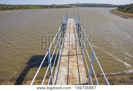 Modern footbridge attached to Dam of Cornalvo Reservoir. This monument is still in use nowadays Extremadura Spain
