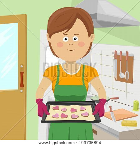 Cute young woman baking cookies in the kitchen