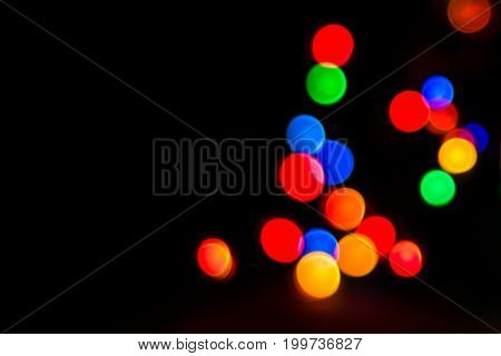 Bright and colorful festive abstraction glowing garlands in blur