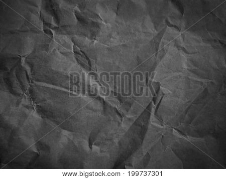 Rumpled grey cardboard paper. Paper texture. Paper background.