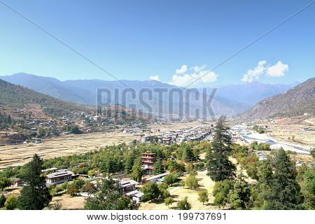 Aerial view of Thimphu City with Bhutanese traditional style houses near a river in Paro Bhutan