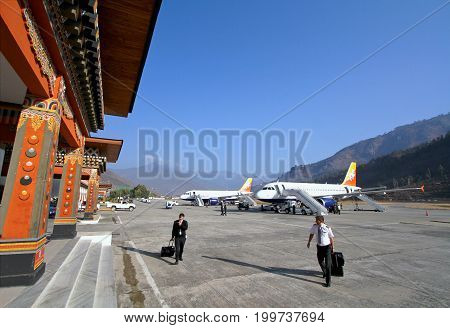 Thimphu Bhutan - November 06 2012: Unidentified pilots with baggage walking in Paro airport after landing with Airbus A319 from Drukair airline Paro Bhutan