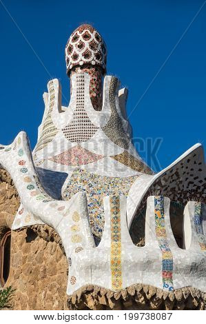 The Park Guell is a public park system composed of gardens and architectonic elements located on Carmel Hill in Barcelona Catalonia Spain