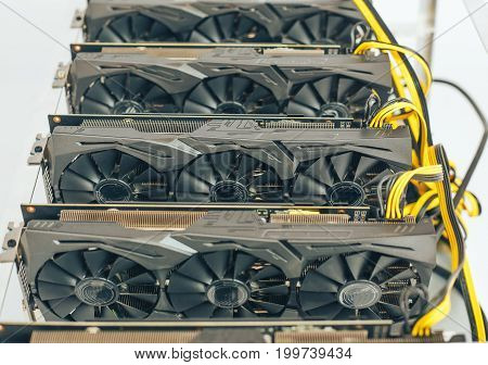 Close-up of several video cards for mining on a white background