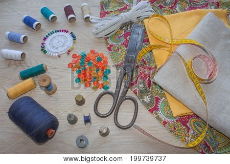Sewing kit. Thread needles and cloth. tailor workspace with sewing and handmade tools. tools for sewing for hobby