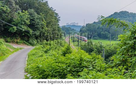 Red  Passenger Train In Countryside