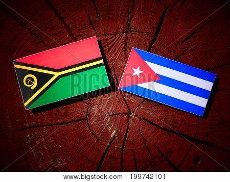Vanuatu Flag With Cuban Flag On A Tree Stump Isolated