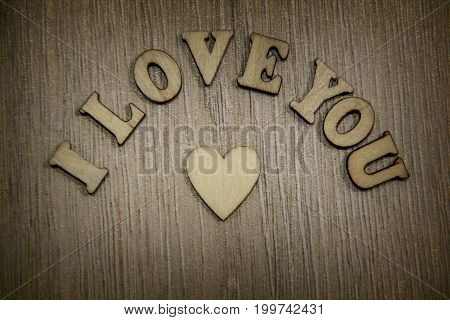 i love you wooden shape heart and letters, love theme.Lovely heart shape by wooden small hearts on rustic wood table. Love theme concept with wooden hearts for Valentine's background and love theme
