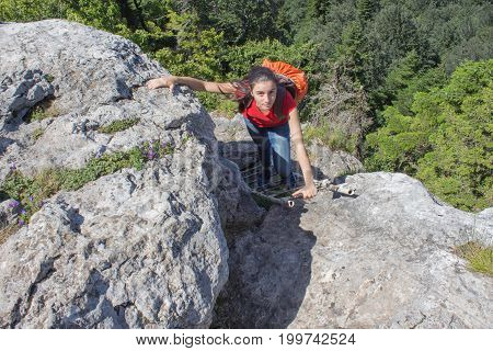 Traveler travel In the mountains reserve. Eco tourism and healthy lifestyle concept. Young hiker girl with backpack. Active hikers