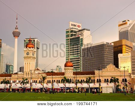 Kuala Lumpur Malaysia - April 22 2017: The Sultan Abdul Samad building in Kuala Lumpur is located in front of the Merdeka Square and modern skyscrapers are in the background.