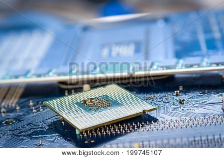 computer cpu or central processor unit chip on mainboard.Technology background with computer processors CPU concept and blue circuit, board texture.
