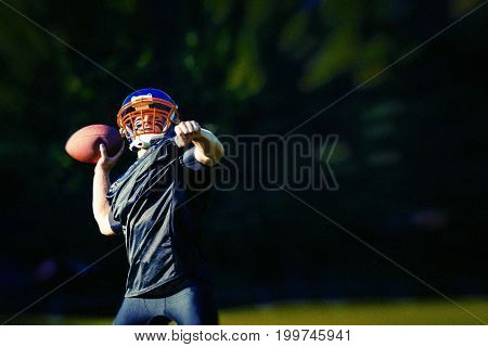 An american football player throwing the ball