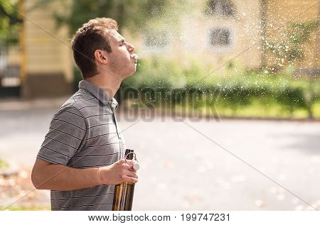 Young Man Spit Out Alcohol