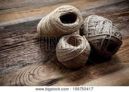 Three Rope Coils On Old Wooden Background