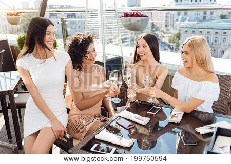 Bachelorette party. Cheerful excited happy woman drinking champagne and enjoying their time while having a bachelorette party