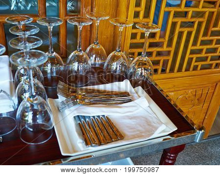 Collection of wine glasses and cutlery on a table in a fine restaurant
