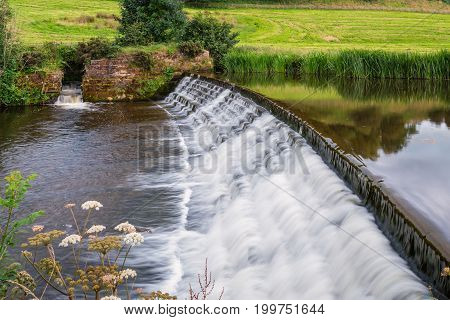 River Aln Weir and Fish Pass. The River Aln runs through Northumberland from Alnham to Alnmouth. Here below Alnwick is one of the weirs along its length