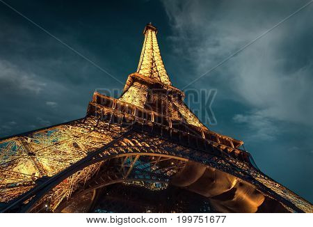 PARIS - JUNE 22: Lighting the Eiffel Tower on June 22, 2016 in Paris. Eluminate Eiffel tower is the most popular travel place and global cultural icon of the France and the world.