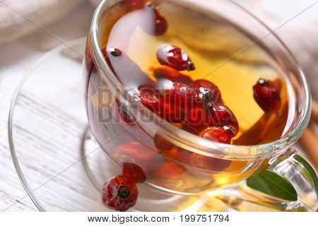 Glass cup with brier tea on table, closeup. Weight loss concept
