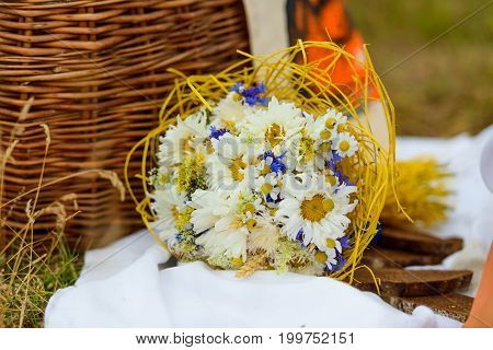 Bouquet of beautiful flowers .Cornflowers, chamomiles wheat and poppies, with copyspace