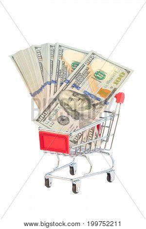 New dollar 100 bills in shopping cart isolated