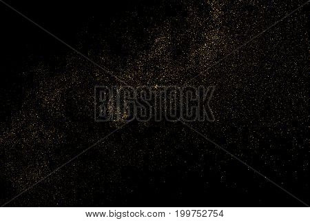 Gold glitter texture isolated on black. Amber particles color. Celebratory background. Golden explosion of confetti. Vector illustrationeps 10.