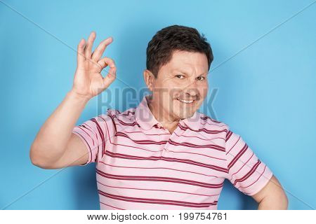 Overweight man on color background. Diet concept