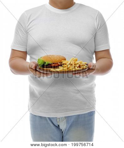 Overweight man holding plate with junk food on white background. Weight loss concept