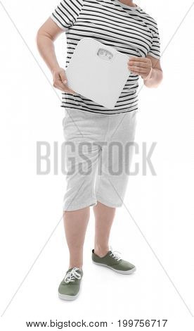Overweight man holding scales on white background. Diet concept
