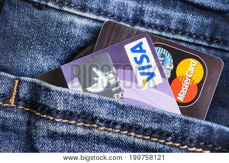 Moscow, Russia - August 05, 2017: Visa and Mastercard credit cards in blue jeans pocket