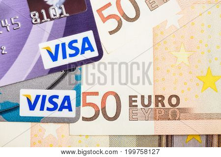 Moscow, Russia - August 05, 2017: Visa credit cards over Euro currency banknotes