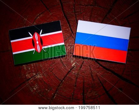 Kenyan Flag With Russian Flag On A Tree Stump Isolated